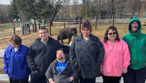 A group of people with disabilities visiting Rosamond Gifford Zoo