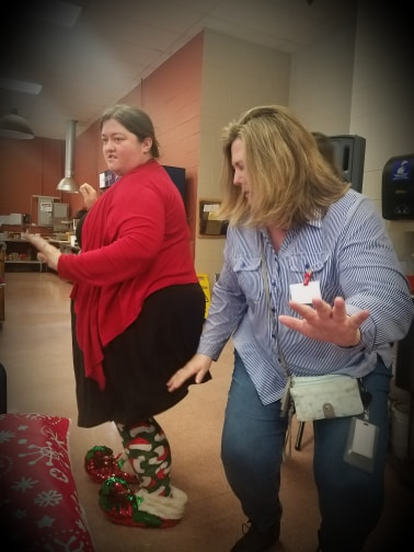 Two employees dancing at the employee Christmas party